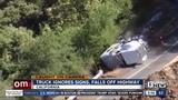 Truck falls into a ravine
