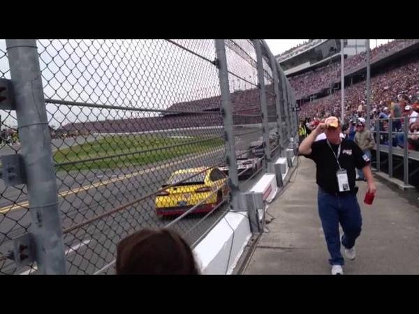 Daytona 500 Close up Along Wall an Fence. Speed.