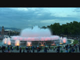 Mount Monjuic. Evening presentation of water, light, music. The magic fountain of Barcelona. National palace