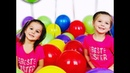 Elya and Adelya playing and popping lots of balloons -