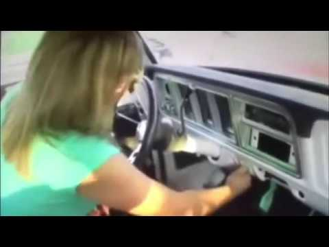 Woman cranking the hell out of the old ford.