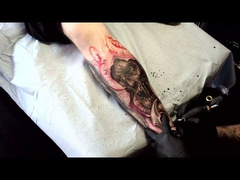 Jeremiah Barba tattooing a freehand zombie with tentacles.