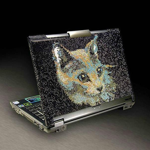 Инкрустация мобильных телефонов кристаллами.