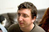 Alex Khakham, Holon