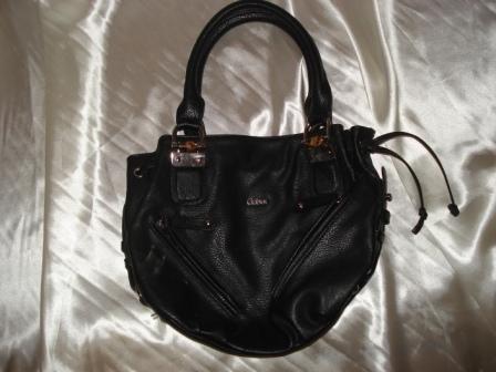 Черная сумка.