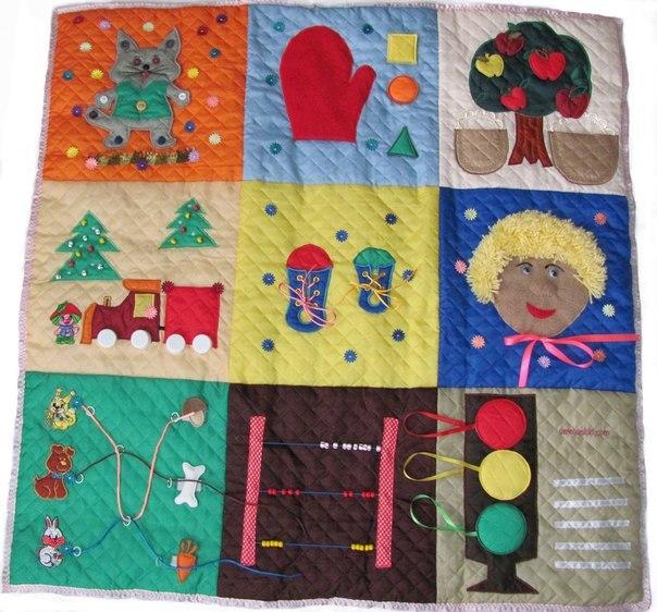3.Развивающий коврик в собранном виде выглядит как сумочка.  Автор.