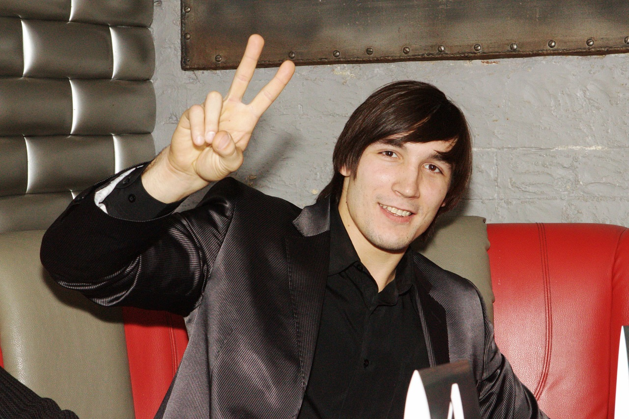 Evgeny Prudnik showing the sign of victory with two fingers, December 2010