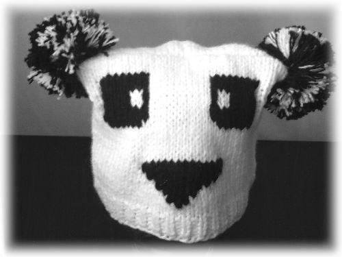 Продаю новые шапку -панда серую и белую,шапку -кошку с ушками...