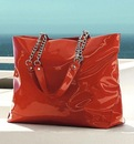 Фотографии Продается красная лаковая сумка.  Абсолютно новая.