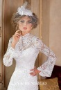 Свадебное платье с рукавами и открытой спиной.