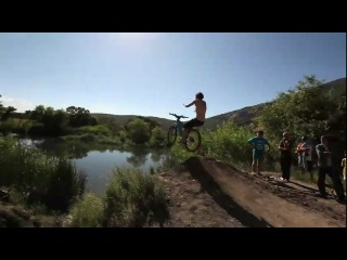 Huge bike jump into a pond 35 feet in the air