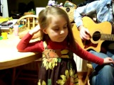 5 year old girl singing her favourite Caitlin Rose song, her dad on guitar.