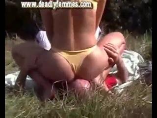 Mature woman grapples him dominates him outdoor