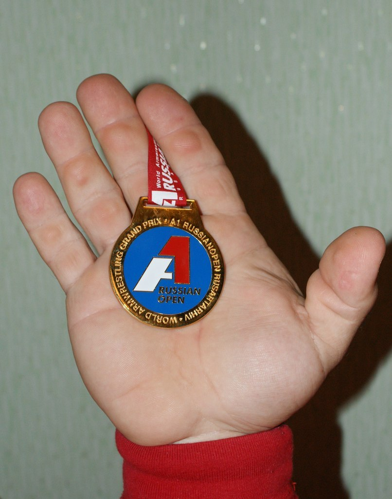 Denis Cyplenkov holds in the right hand one of his medals from A1 Russian Open 2012