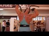 Подтягивания за голову в тренажере (верх широчайших мышц спины)
