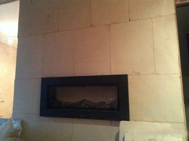 электрокамин на стене