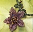 """Фиолетовая лилия Колье  """"Лилия """" сплетенное из бисера.  Цветок состоит из пяти лепестков, которые плетутся с..."""