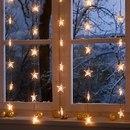 Позаботься о прохожих: если ты живешь не на верхнем этаже, украшенное окно поднимет настроение...