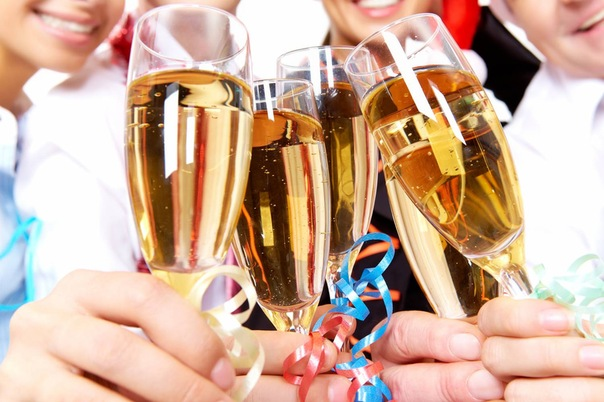 ...glasses full of champagne held by human hands Stock Photo - 8225910.