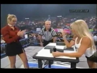 Major Gunns vs. Miss Hancock in an arm wrestling match
