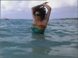 Joan Collins in swimwear