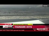 Tsunami waves crash ashore in Japan pacific coast 2011 earthquake aftershock
