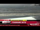 Tsunami waves crash ashore in Japan pacific coast 2011 earthquake aftershock