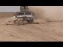 Иракские ополченцы возвращаются из боя