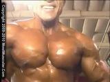 MostMuscular.com - posing biceps