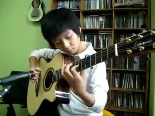 моодой виртуоз гитарист