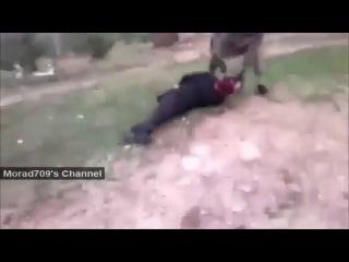 отрезание головы на скорость в Сирии