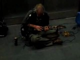 Tim The legendary street guitarist doing a guitar improvisation full of tapping and speed down the stairs of the Opera Bastille