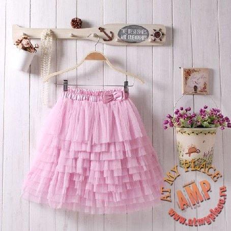 Пышная многослойная розовая юбка-пачка из сетки.