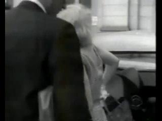 Marilyn Monroe and Arthur Miller at train station, 1957.