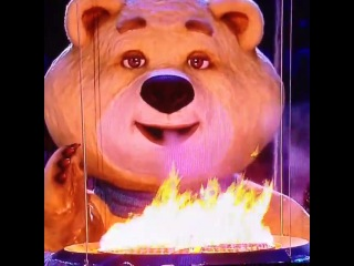The giant  bear blows out the #olympic flame!