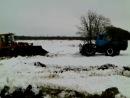 Трактор Т-150 и погрузчик Амкодор.