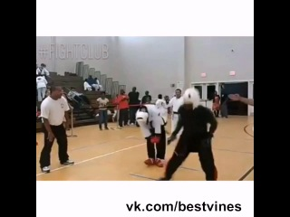 Crazy spinning hook kick during a karate match