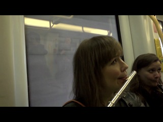 "Flash mob in the copenhagen metro. copenhagen phil playing ""peer gynt""."