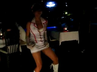 Hot sexy nurse dancing at Ocean Beach Kuta Bali