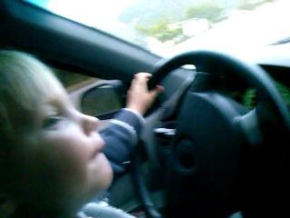 Три годика,учимся ездить на машине)))