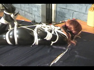 Jade in pvc catsuit hogtied gagged and blindfold with vibrator