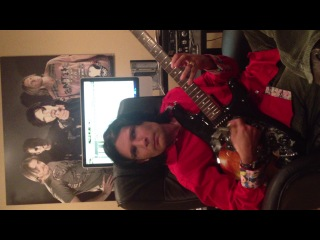 Corey Feldman plays guitar..