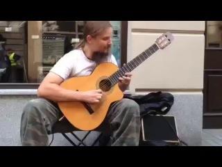 Уличный гитарист-виртуоз поляк Мариуш Голи