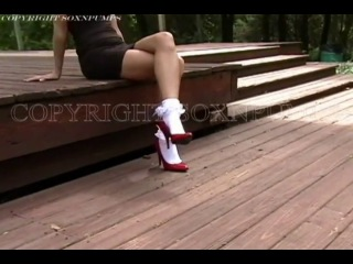 Makenna in little black dress, red patent pumps and frilly socks