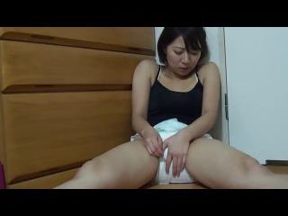 Girl peeing in diaper...