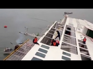 Dramatic rescue operation of ferry passengers seen in aerial video off South Korea coast