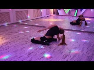 Floorwork. acrobatic strip. strip dance on the floor.