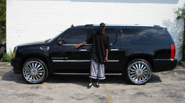 Larry Hughes with his Escalade