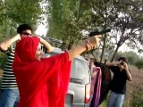 A Pakistani girl firing with closed eyes - FacesOfPakistan