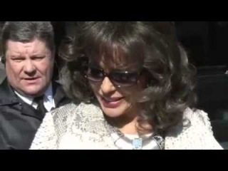 Joan Collins Makes An Effor To Look Good